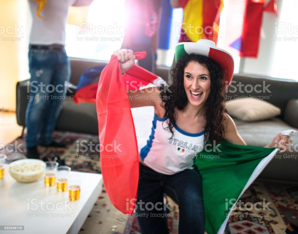italian supporter woman at home looking the tv stock photo