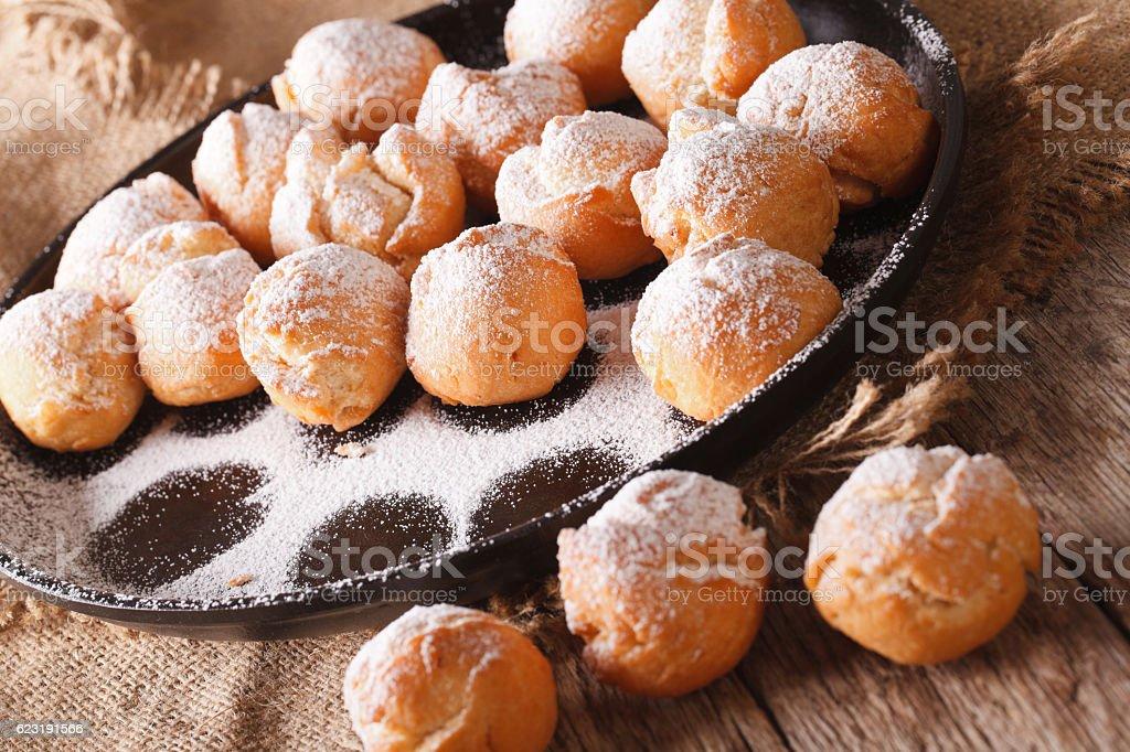 Italian sweet donuts Castagnole close-up on the table. Horizontal stock photo