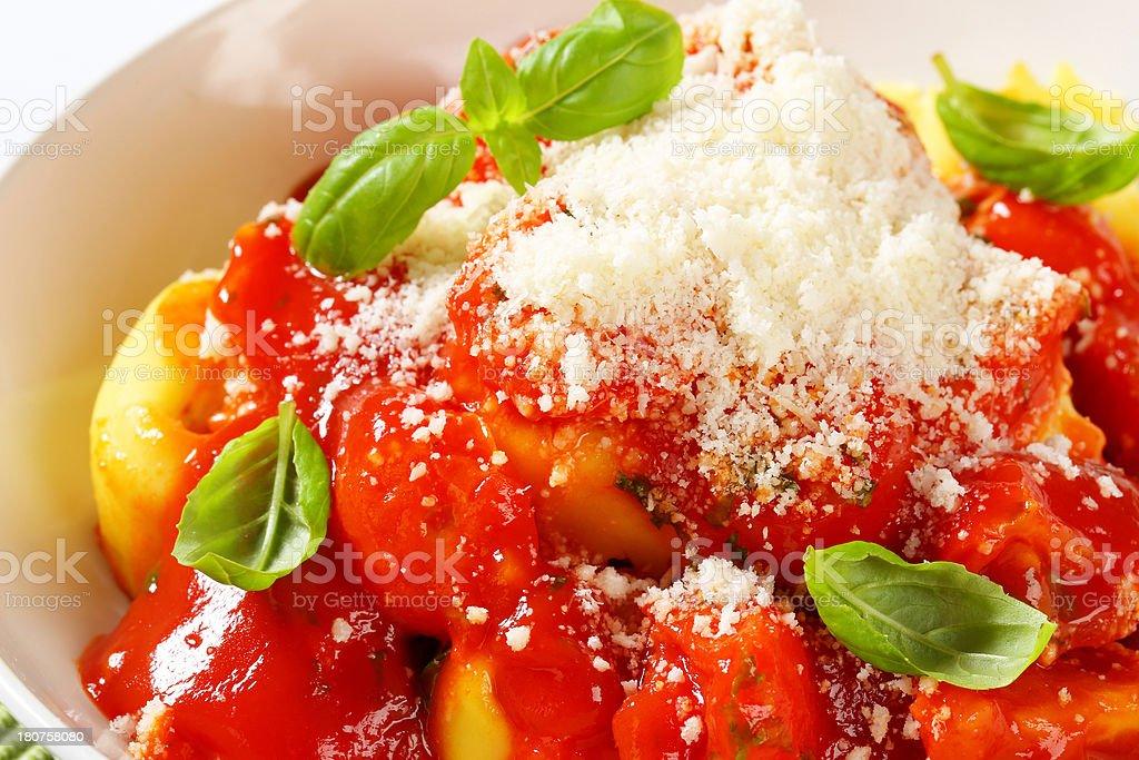 italian tortellini with tomato sauce stock photo