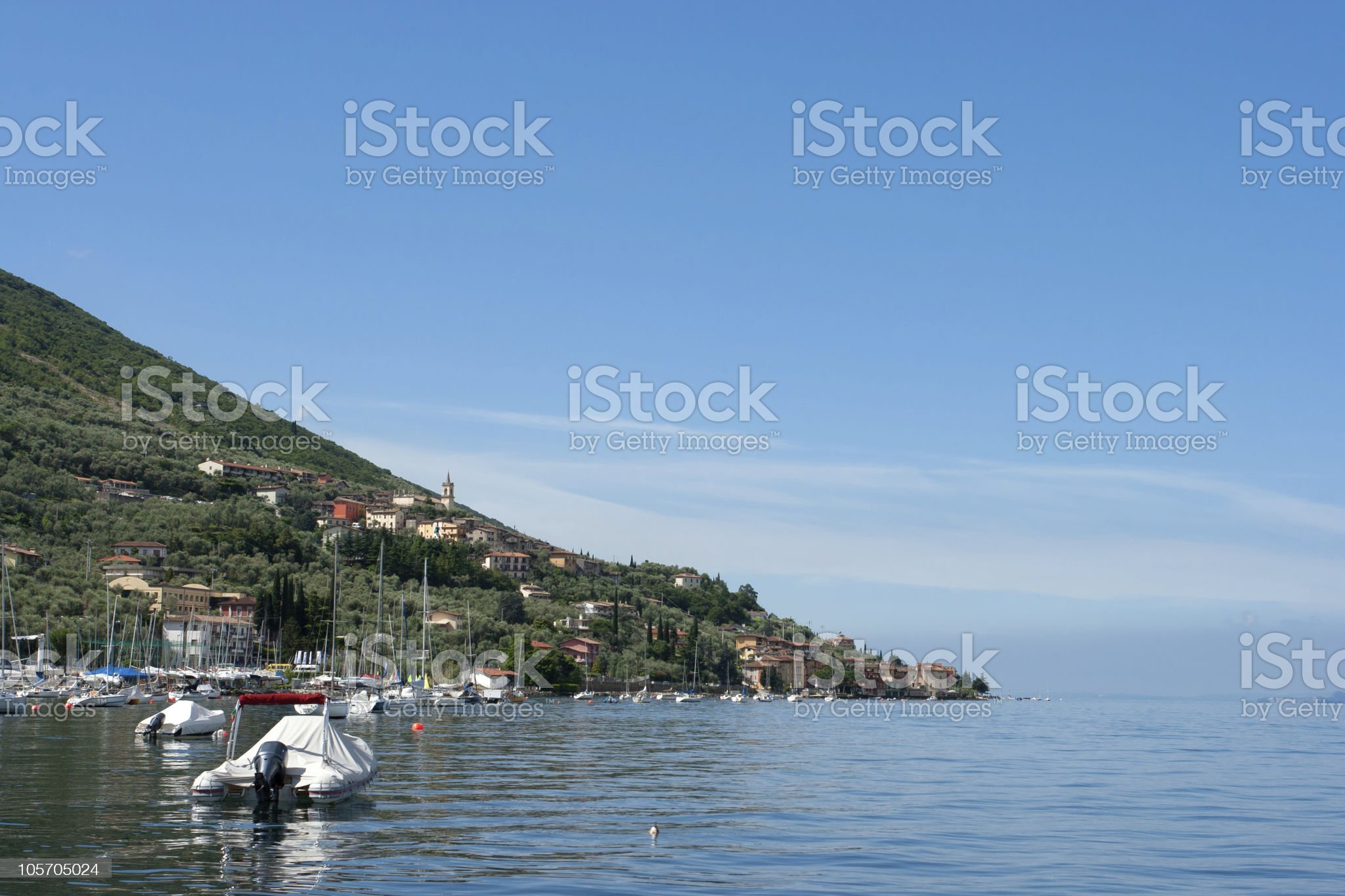 Italian Town with little Port in front of Garda lake royalty-free stock photo
