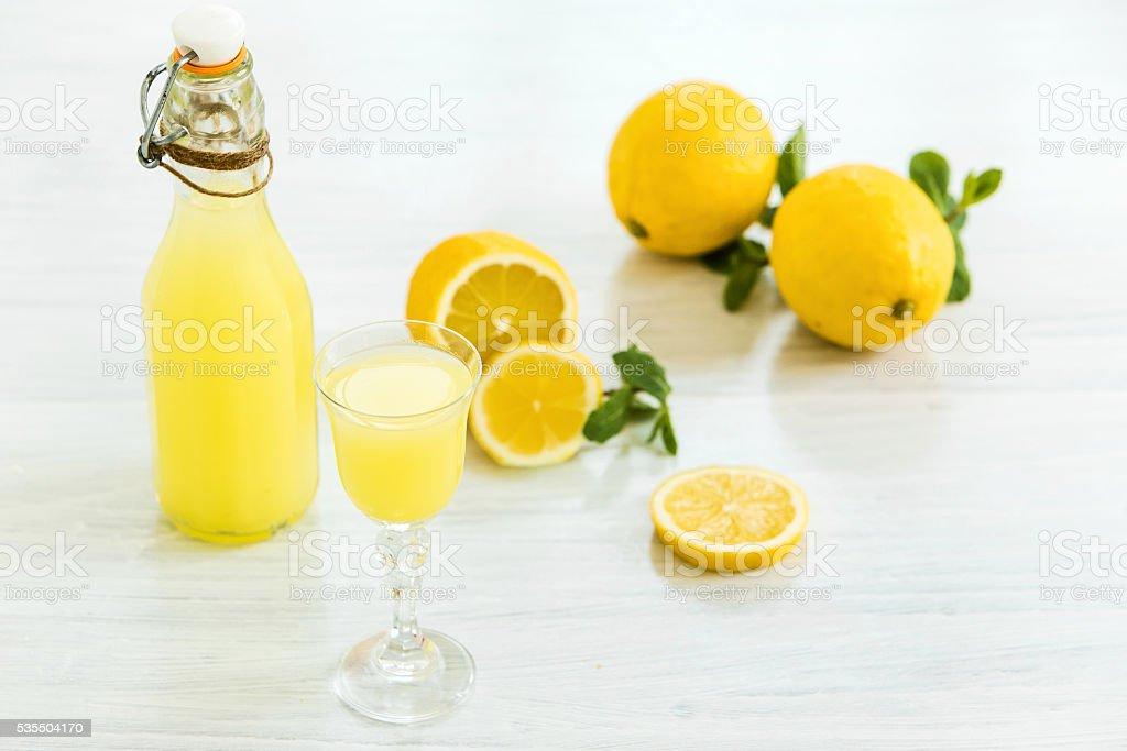 Italian traditional liqueur limoncello with lemon stock photo