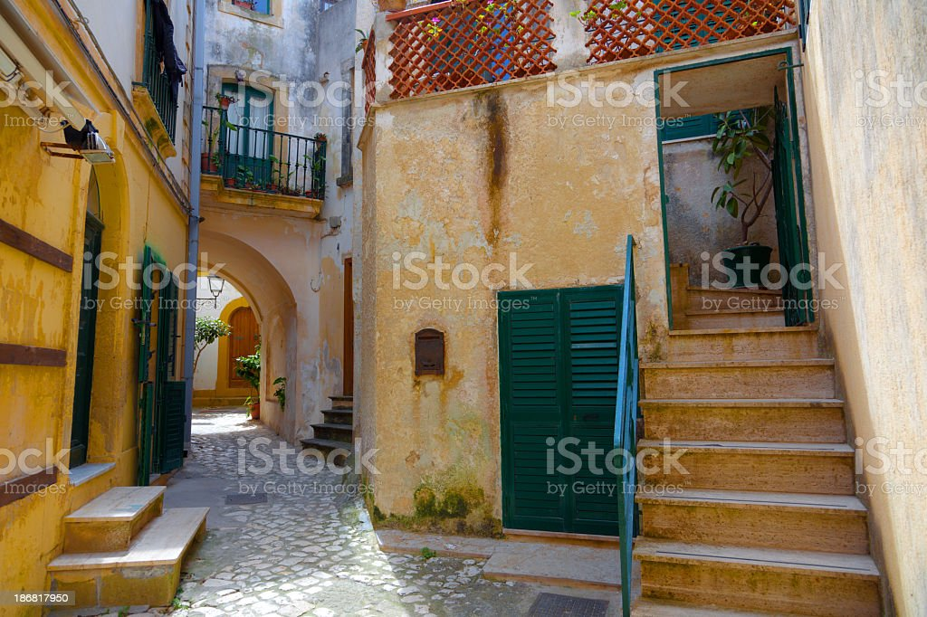 Italian Village Alley With Doors and Steps royalty-free stock photo