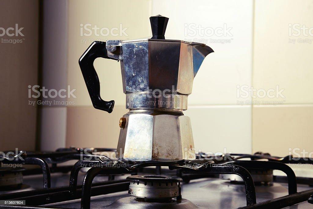 Italian vintage coffeepot on kitchen stove stock photo
