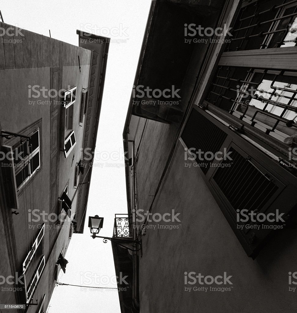 Italian windows and rooftops, with streetlamp against sky stock photo