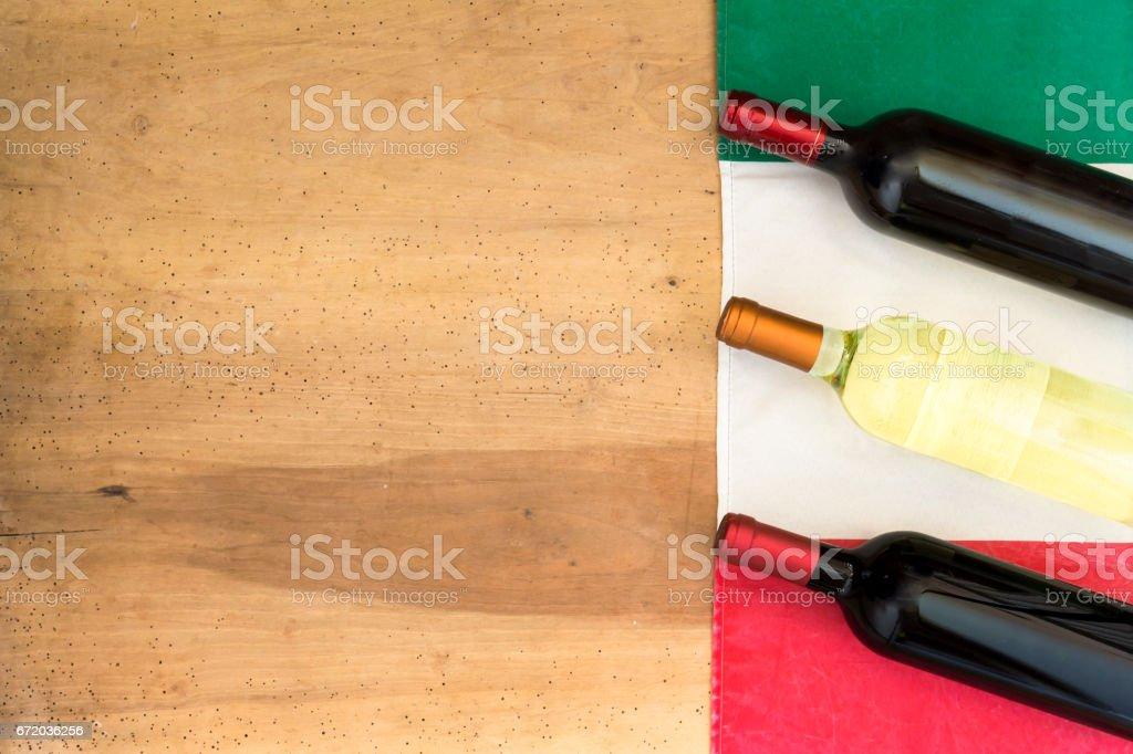 Italian wine bottles on wooden background stock photo