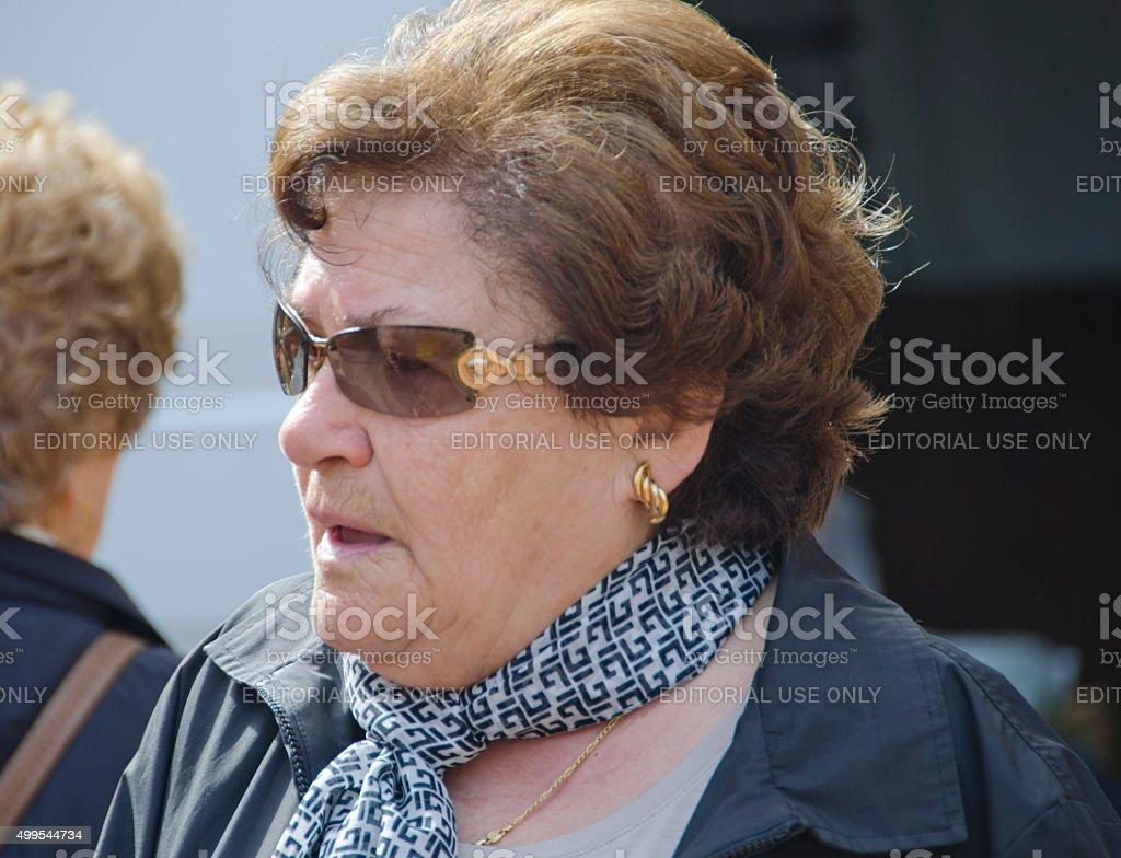 Italian Woman at Farmers Market in San Gimignano, Italy stock photo