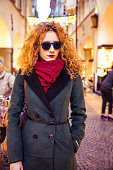 Italian woman wearing sunglasses at late afternoon in the city