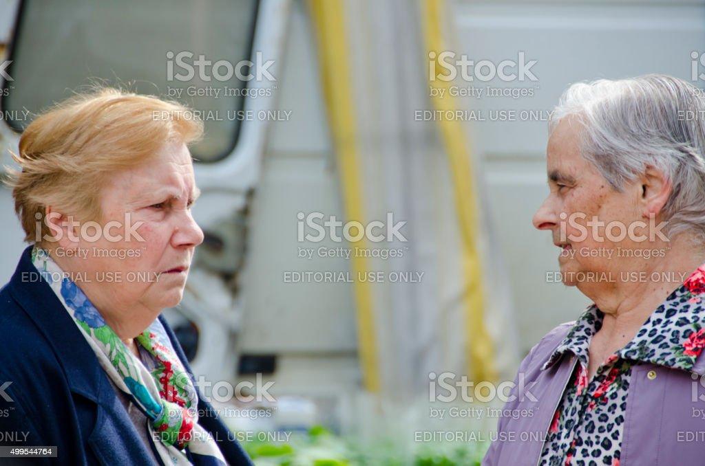 Italian Women at Farmers Market in San Gimignano, Italy stock photo