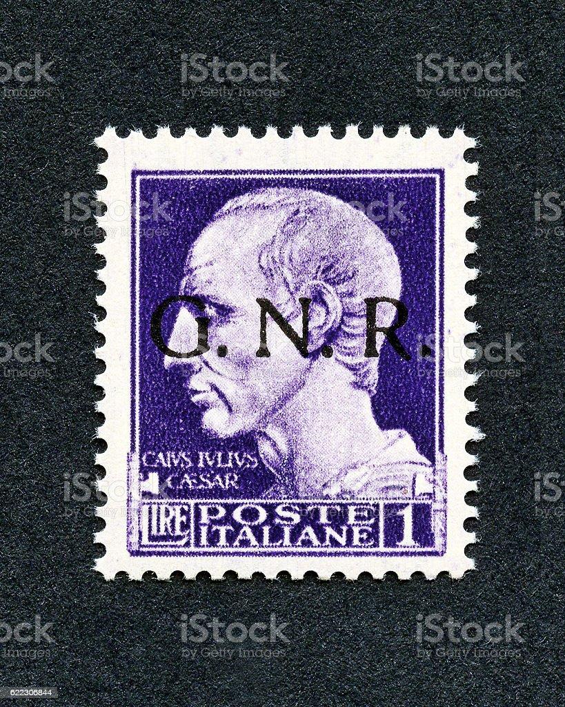 Italy 1943 stamp : 1 Lira overprint GNR stock photo