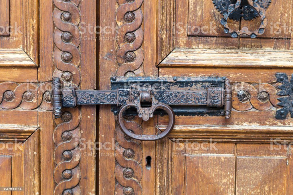 Italy: Close up of rustic old door stock photo