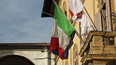 Italy flag and Siena city council coat of arms