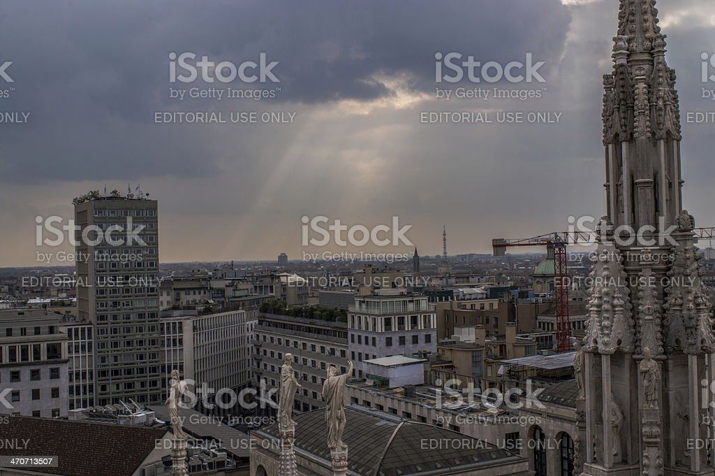 Italy, Milan skyline with sun rays and gothic spire royalty-free stock photo