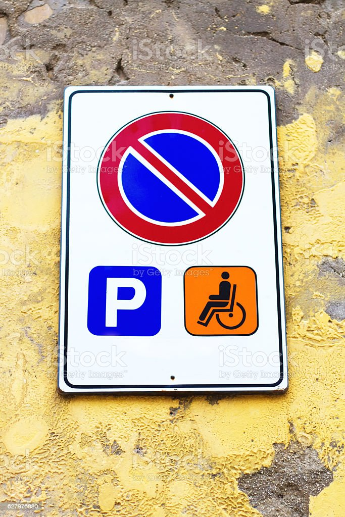 Italy: No Parking Sign/Symbol; Handicapped Parking Only stock photo