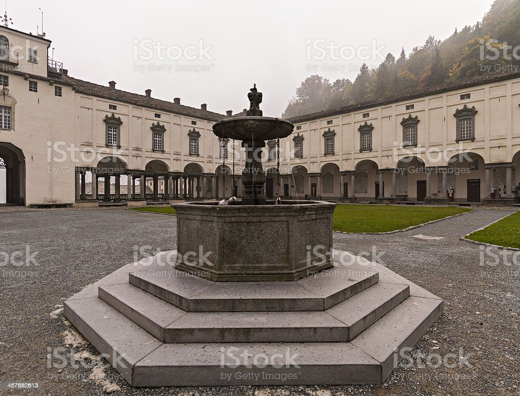 Italy. Piedmont. Fountain in the courtyard (Sacred Mount of Oropa) stock photo