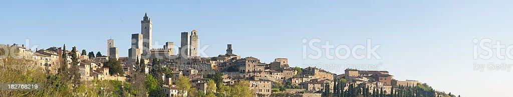 Italy San Gimignano Tuscany medieval village landmark towers spring panorama stock photo