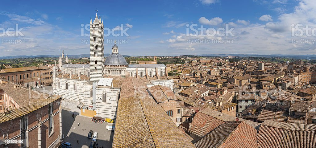 Italy terracotta rooftops and medieval Duomo di Siena panorama stock photo