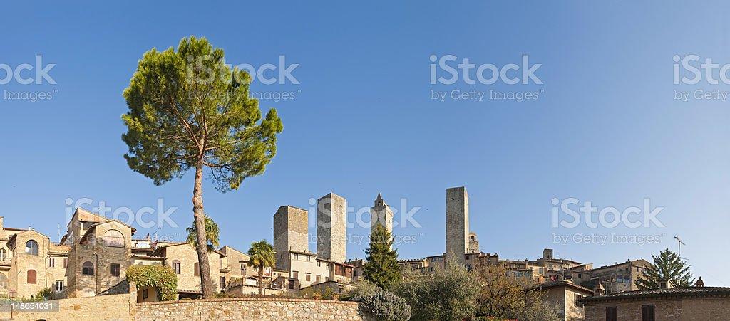 Italy Tuscany San Gimignano medieval village towers summer sunrise panorama stock photo