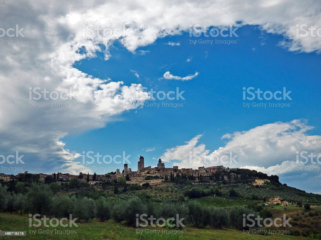 Italy, Tuscany, San Gimignano,  the Tuscan countryside with clouds stock photo