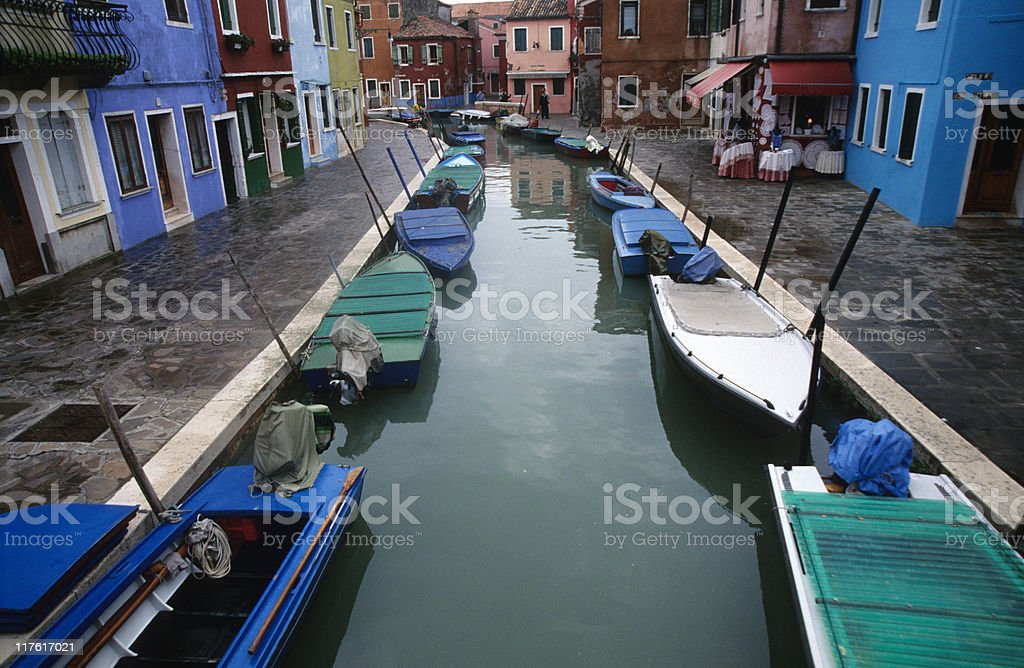 Italy, Venice, boats moored in canal, elevated view royalty-free stock photo