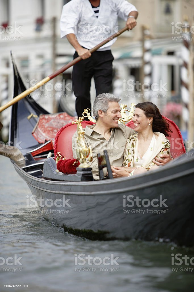 Italy, Venice, couple in gondola, smiling royalty-free stock photo