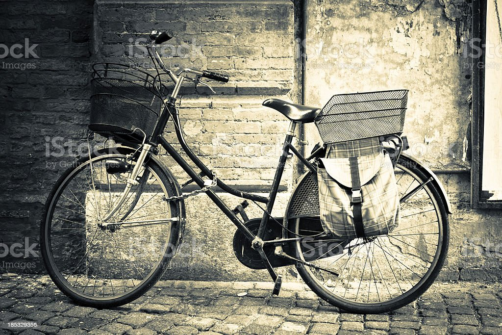 Italy Vintage Bicycle With Old Palace as Background sepia Toned royalty-free stock photo