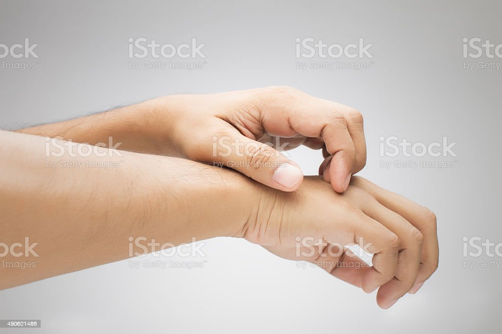 Itching In a man stock photo