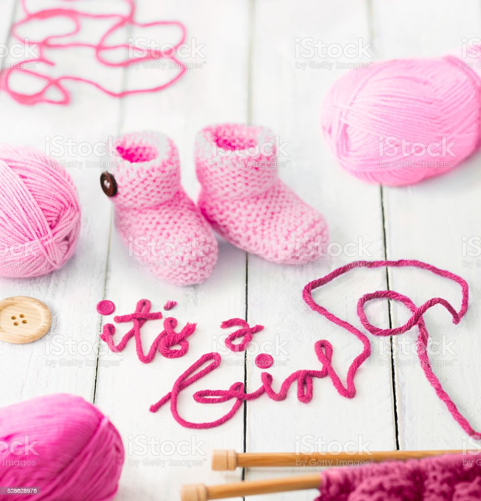 It's a Girl announcement message made from blue wool yarn stock photo