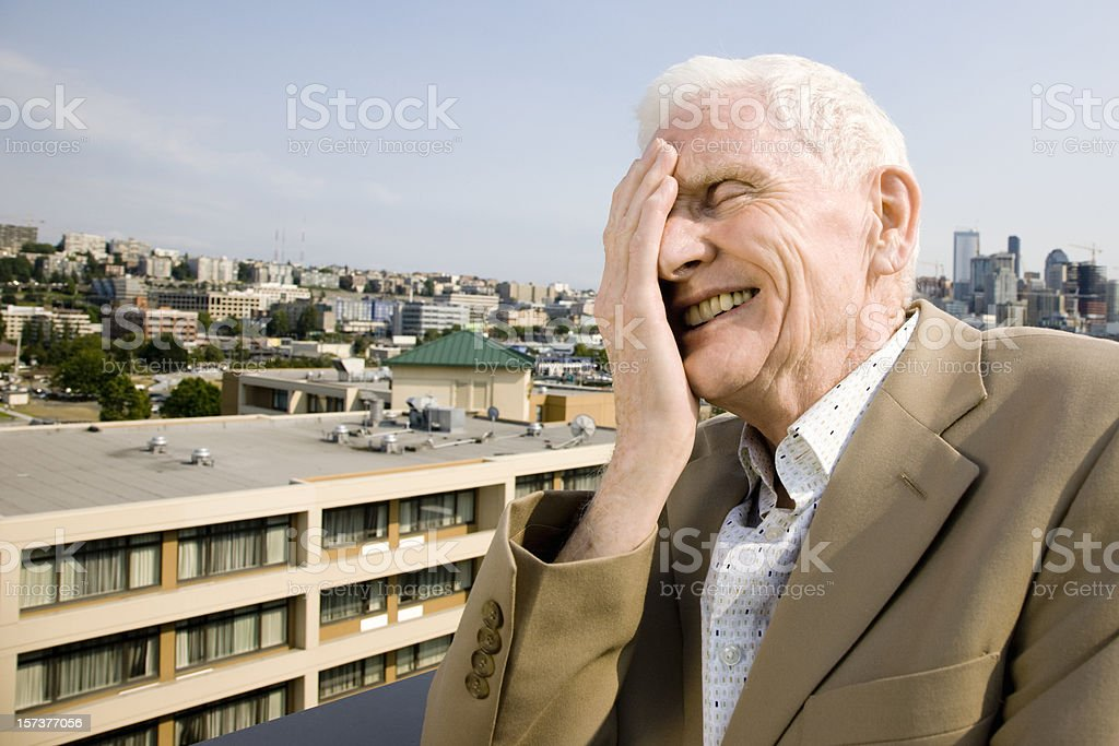 It's a ridiculous, mad world. Senior Man laughing. royalty-free stock photo