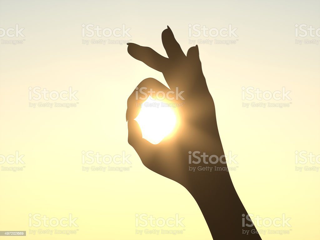 It's All Right - Hand in front of Sun stock photo