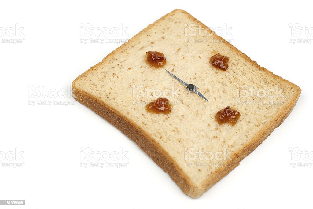 It's breakfast time! The bread clock is shown 6 o'clock. royalty-free stock photo