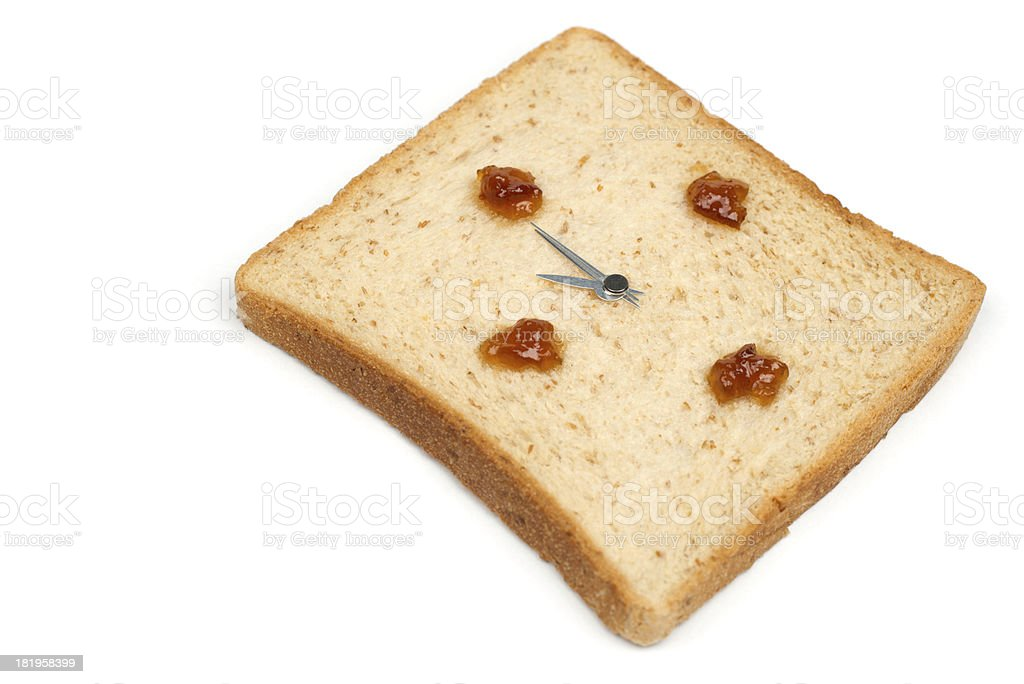 It's brunch time! The bread clock is shown 11 o'clock. royalty-free stock photo