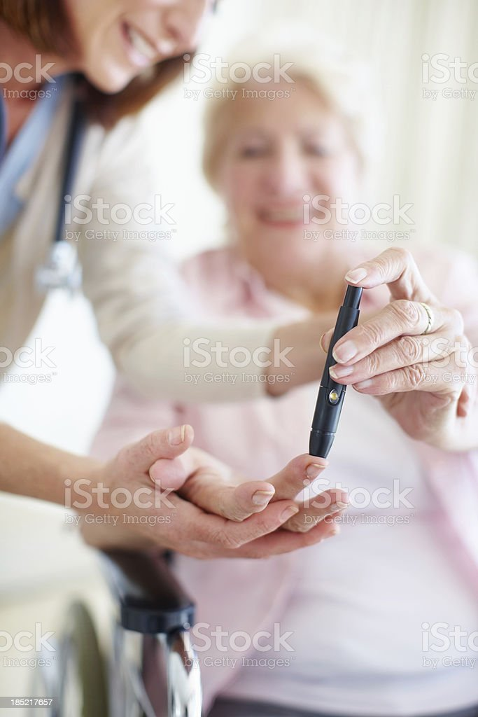 It's easy to check your blood-sugar levels - Diabetes/Senior Care stock photo