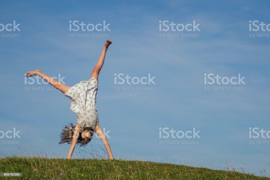 It's fun to cartwheel stock photo