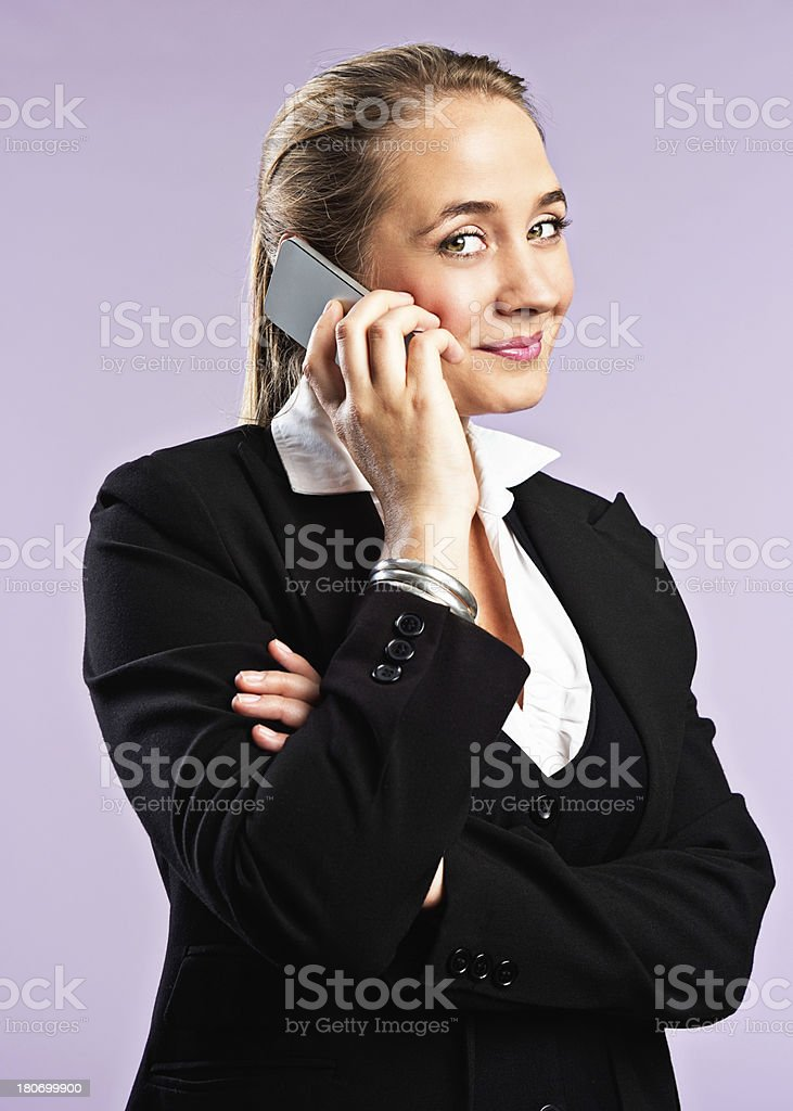 It's good news! Pretty blonde talking on phone smiles happily stock photo