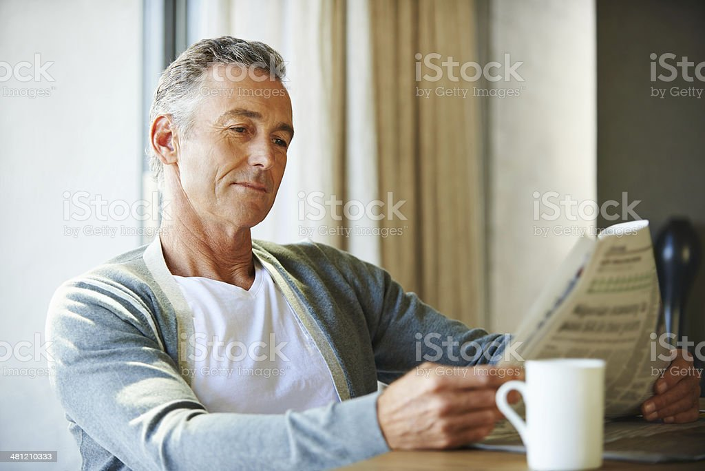 It's his favorite morning routine... stock photo