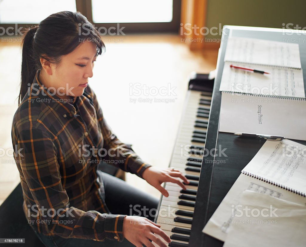 It's just her and the piano stock photo