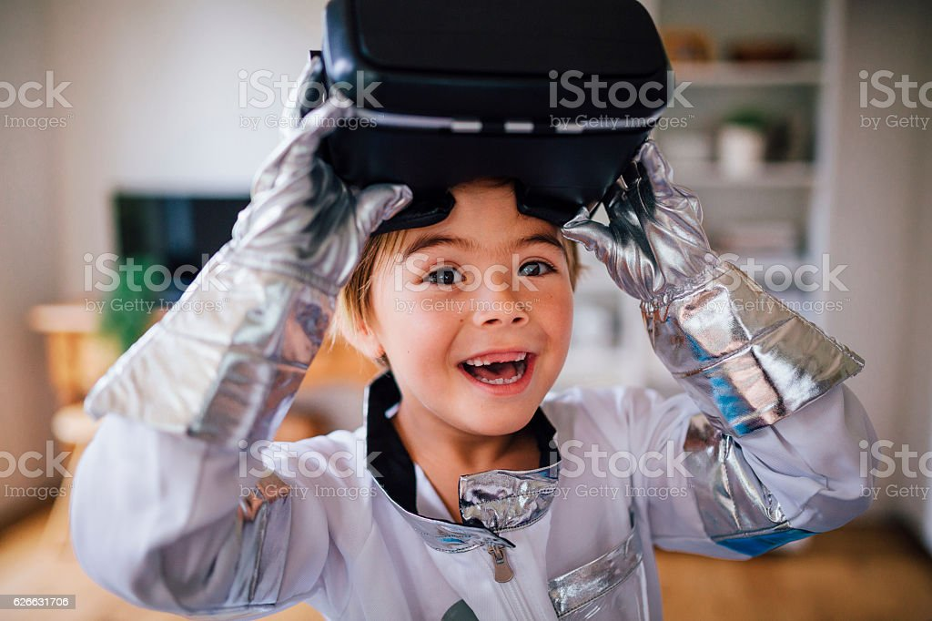 It's like I'm actually in space with my VR headset! stock photo