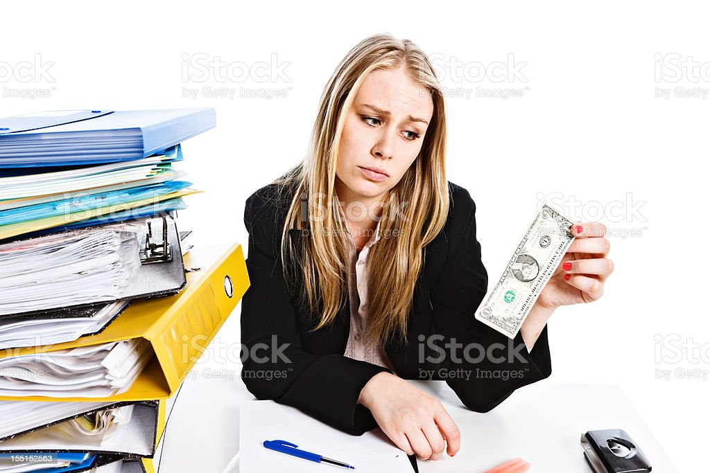It's not enough: sad overworked businesswoman  with single dollar bill stock photo