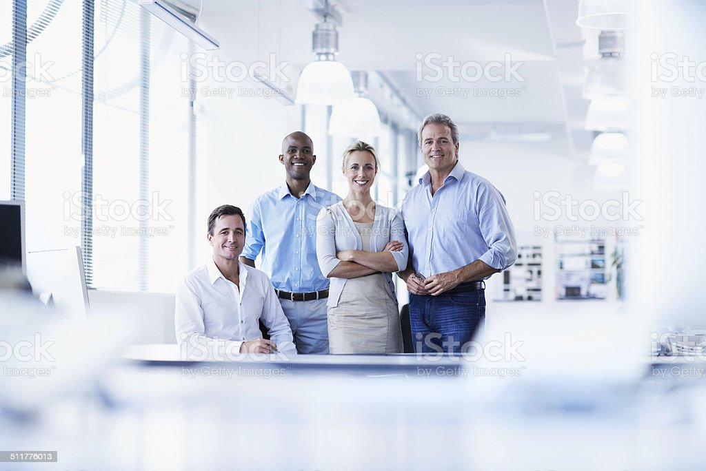 Portrait of a diverse group of smiling businesspeople in an office