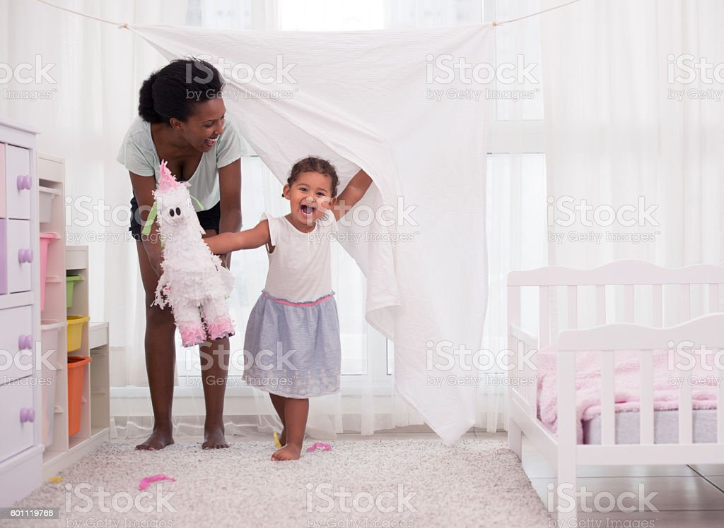 It's show time. Mother and daughter home theatre performance. stock photo