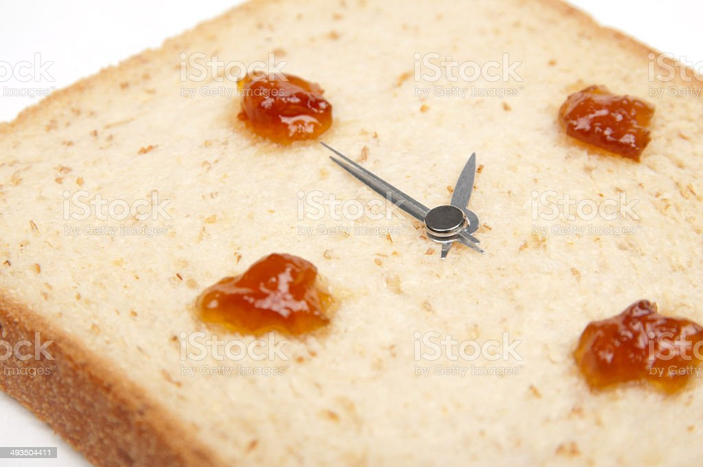 It's tea time! The bread clock is shown 2 o'clock. stock photo