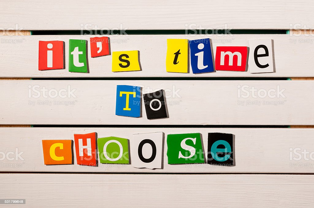 It's time to choose - written with color magazine stock photo