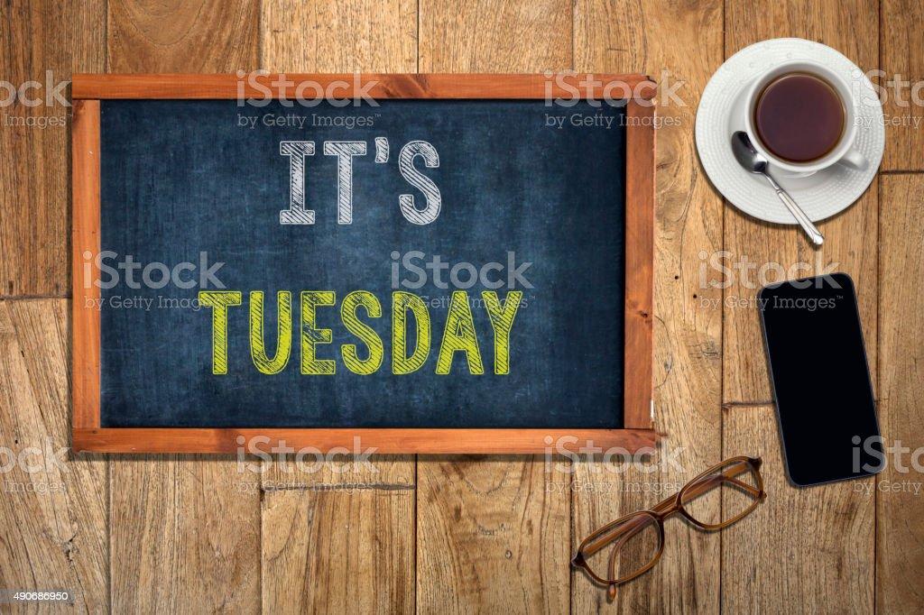 It's Tuesday Concept on blackboard stock photo