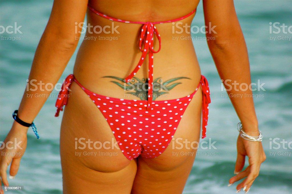 Itsey Bitsy Bikini and tatoo royalty-free stock photo