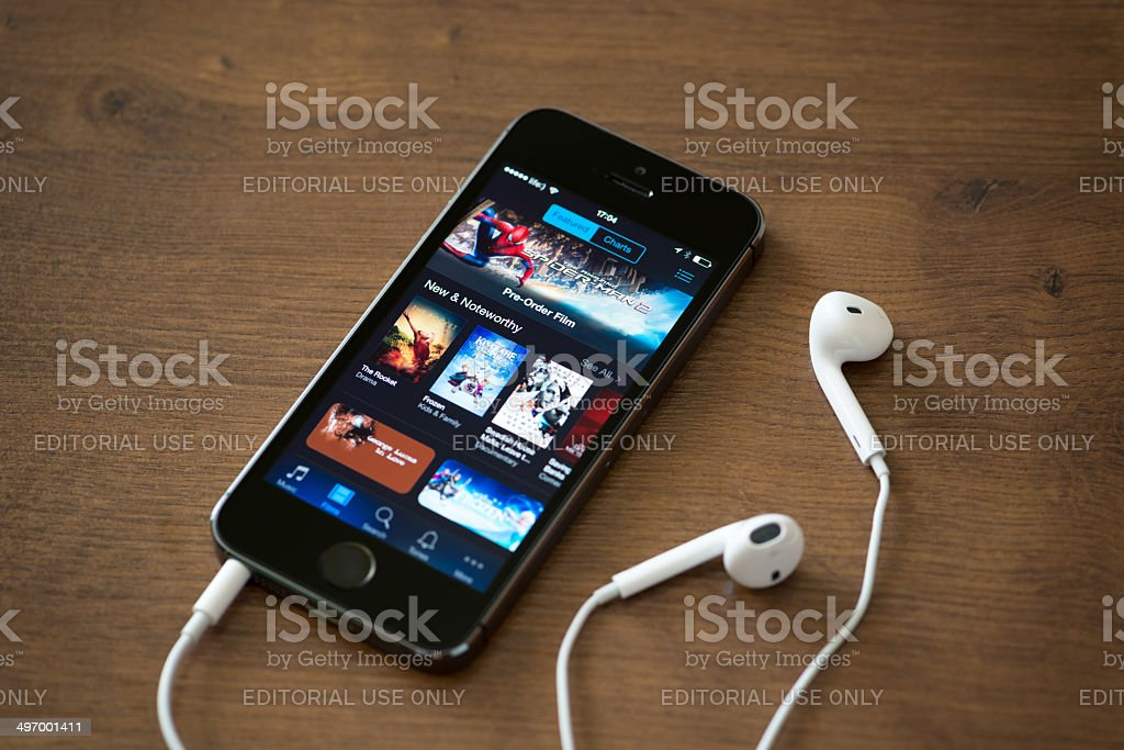 iTunes application on Apple iPhone 5S stock photo