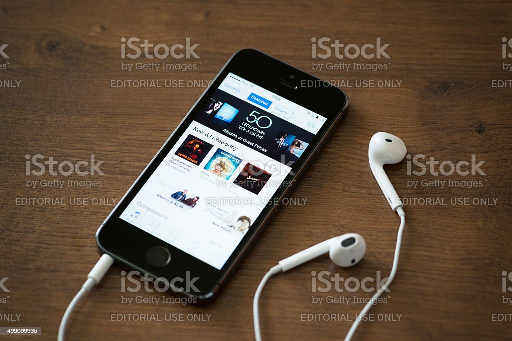 iTunes music charts on Apple iPhone 5S stock photo