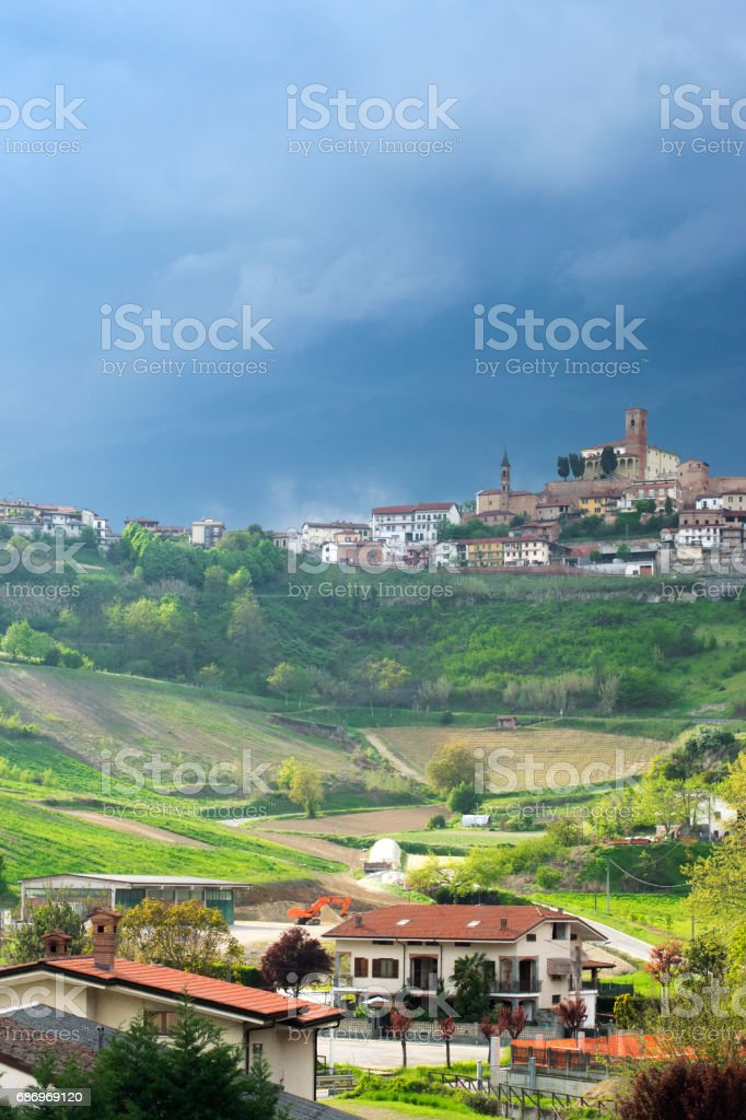 Сity Cisterna d'Asti, province of Piedmont, Italy before a thunder-storm stock photo