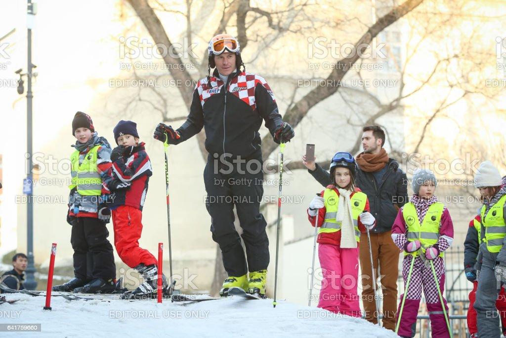 Ivica Kostelic skiing with kids stock photo