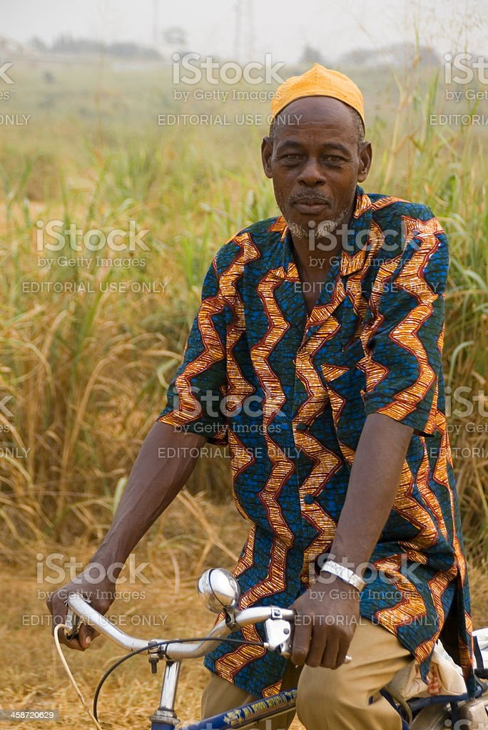 Ivorian man on his bicycle stock photo