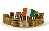 Ivory Coast flag waving with stack of money coins